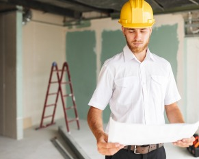 architect holding home plans